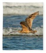 Long-billed Curlew Flying Over The Surf Fleece Blanket