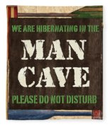 Man Cave Do Not Disturb Fleece Blanket by Debbie DeWitt
