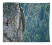 Man Climbing On A Big Granite Spire Fleece Blanket