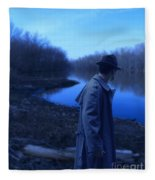 Man In Fedora By River Fleece Blanket