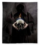 Man In The Hooded Cloak Holding Burning Human Skull In His Hand Fleece Blanket