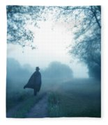 Man In Top Hat And Cape On Foggy Dirt Road Fleece Blanket