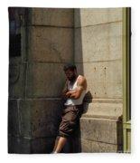 Man Leaning Against Wall In Sun Fleece Blanket