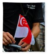 Man Plants Singapore Flag On Bicycle Fleece Blanket