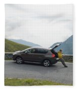 Man Rests On Trunk Of Car On Mountain Fleece Blanket