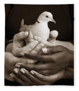 Many Hands Holding A Dove Fleece Blanket