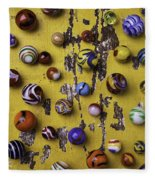Marbles On Yellow Wooden Table Fleece Blanket