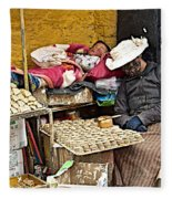Nap Time For Child And Street Shopkeeper In Lhasa-tibet   Fleece Blanket