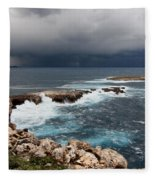 Wild Rocks At North Coast Of Minorca In Middle Of A Wild Sea With Stormy Clouds Fleece Blanket