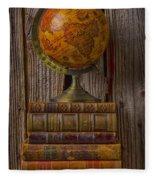 Old Globe On Old Books Fleece Blanket