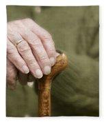 Old Hands Of A Senior On Walking Stick Fleece Blanket