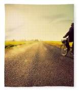 Old Man Riding A Bike To Sunny Sunset Sky Fleece Blanket