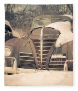 Old Plymouth Classic Car In The Snow Fleece Blanket