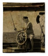 old sailor A vintage processed photo of a sailor sitted behind the rudder in Mediterranean sailing Fleece Blanket