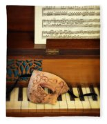 Ornate Mask On Piano Keys Fleece Blanket