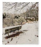 Park Bench In The Snow Covered Park Overlooking Lake Fleece Blanket