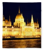 Parliament Building At Night In Budapest Fleece Blanket