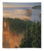 Perce Rock And The Three Sisters In Fog Fleece Blanket
