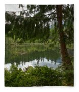 Pine Trees Over Starvation Lake Fleece Blanket