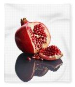 Pomegranate Opened Up On Reflective Surface Fleece Blanket