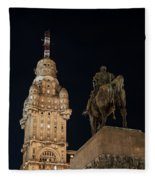 Public Statue And Skyscraper At Night Fleece Blanket
