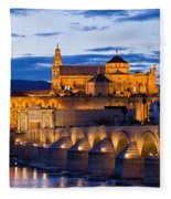 Puente Romano And Mezquita At Twilight In Cordoba Fleece Blanket