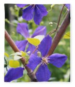Purple Clematis Clinging On A Fence Fleece Blanket