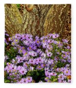 Purple Flowers At Base Of Tree Fleece Blanket