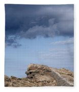 Cala Mesquida Stone Wall Against Rocks With A Stormy Sky Above - Putting Walls To Heaven Fleece Blanket