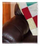 Quilt Beside A Fireplace Fleece Blanket