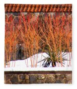 Red Bushes And Rock Wall Fleece Blanket