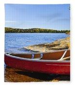 Red Canoe On Shore Fleece Blanket