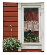 Red Wooden House With Plants In And By Fleece Blanket