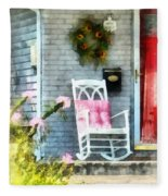 Rocking Chair With Pink Pillow Fleece Blanket