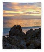 Rocky Shoreline At Sunset Fleece Blanket