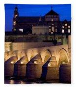 Roman Bridge And Mezquita In Cordoba At Dawn Fleece Blanket