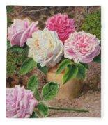 Roses In An Earthenware Vase By A Mossy Fleece Blanket