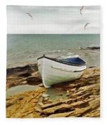 Row Boat On Rocky Shore Fleece Blanket