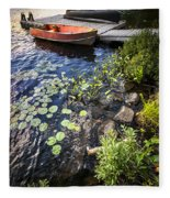 Rowboat At Lake Shore Fleece Blanket