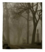 A Graveyard Seeped In Fog Fleece Blanket
