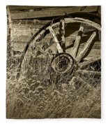 Sepia Toned Photo Of An Old Broken Wheel Of A Farm Wagon Fleece Blanket
