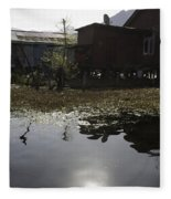 Shack And House Along With Weeds Right On Shore Of Dal Lake Fleece Blanket