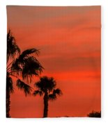 Silhouetted Palm Trees Fleece Blanket