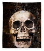 Skull In Earth Fleece Blanket