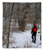Snowshoeing In The Park Fleece Blanket