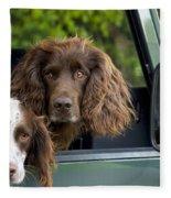Spaniels In Car Fleece Blanket