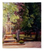 Statue In  Landscape Fleece Blanket