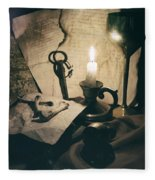 Still Life With Bones Rusty Key Wine Glass Lit Candle And Papers Fleece Blanket