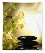 Stone Cairn And Orchids Fleece Blanket by Olivier Le Queinec