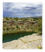 Storm Clouds Over Montezuma Well Fleece Blanket